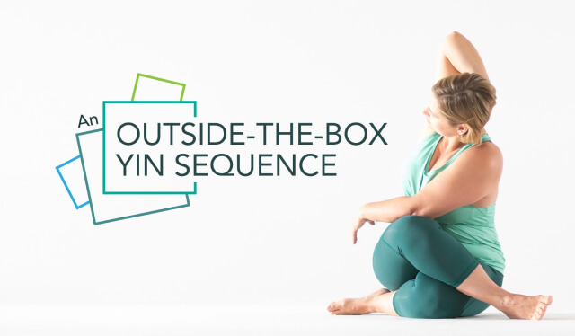 Woman practicing an outside-the-box yin yoga pose