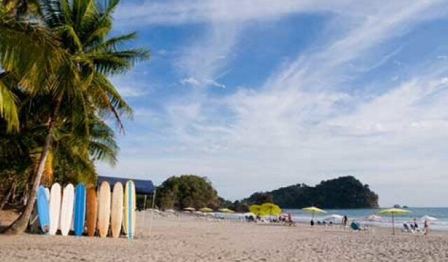 Beautiful Costa Rican beach with surfboards