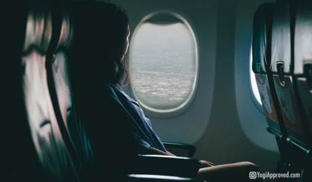 Woman on a plane looking out the window