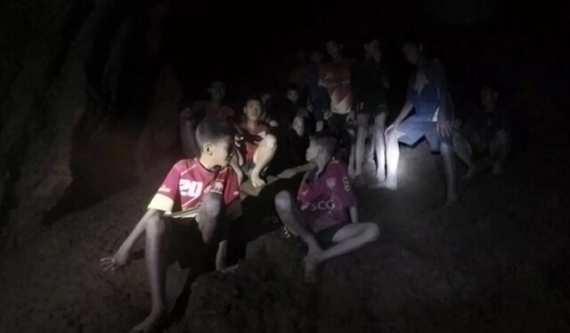 Thai soccer team trapped in a dark cave with flashlights