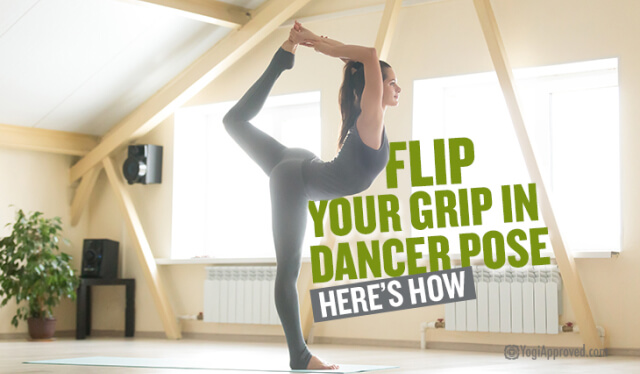 Woman practicing king dancer's pose (natarajasana) with a flipped grip in front of a bright window