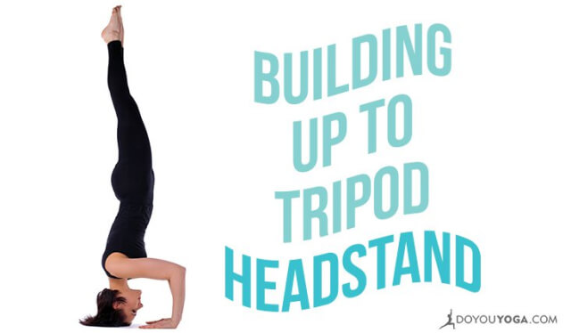 Woman practicing tripod headstand (salamba sirsasana II) against a white backdrop