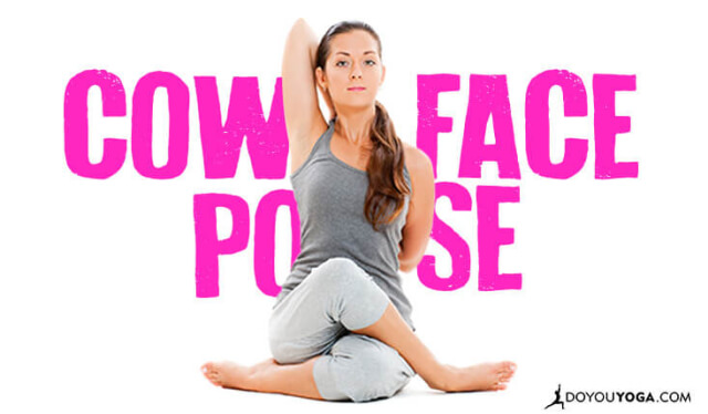 Woman practicing cow face pose (gomukhasana) against a white backdrop