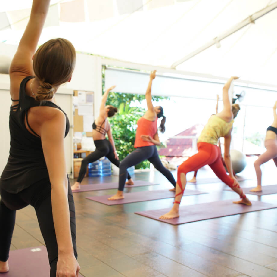 Yoga teacher leading a yoga class in a studio