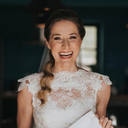 Young woman smiling in her wedding dress