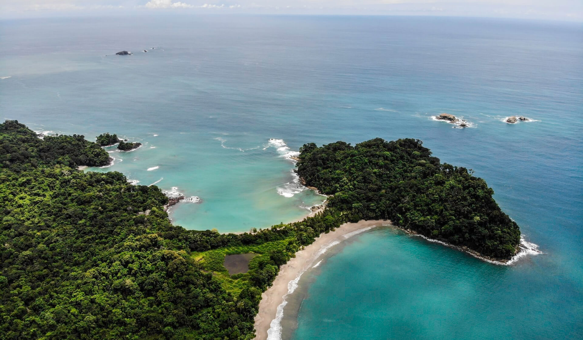 Aerial view of a stunning beach and jungle landscape in Manuel Antonio, Costa Rica