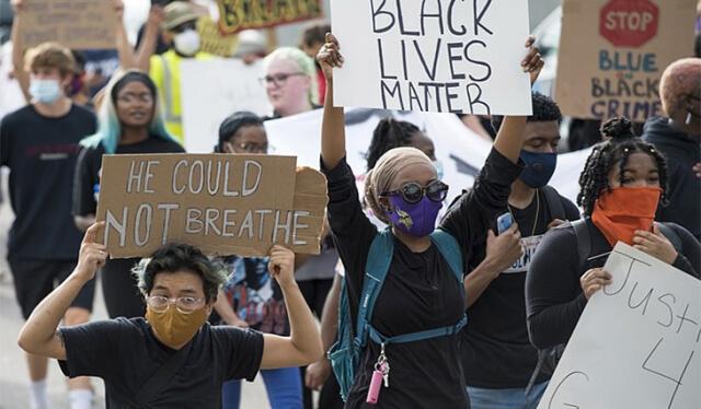 #BlackLivesMatter protestors holding signs in the street