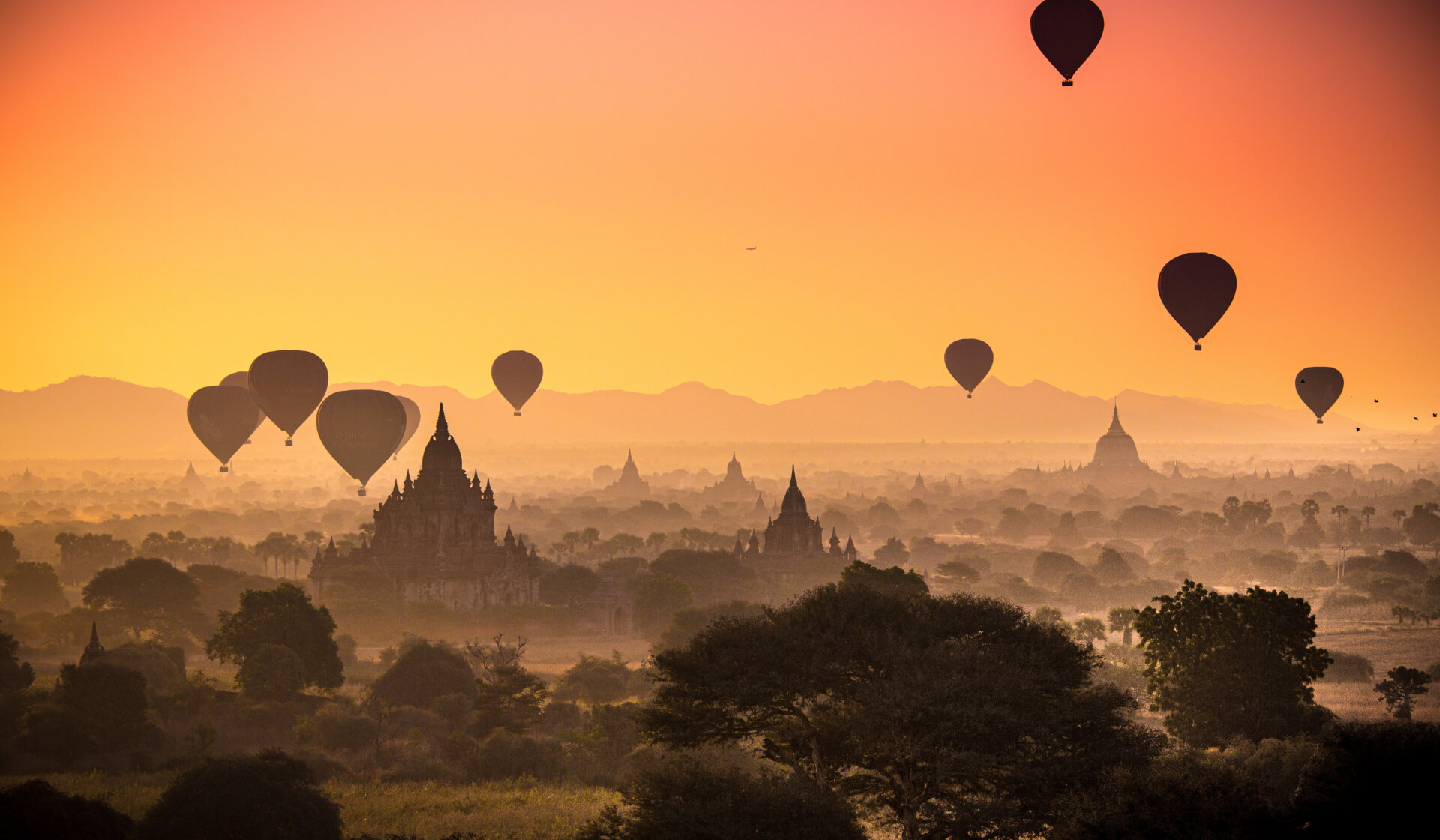 Sunrise over Bagan, Myanmar with thousands of temples and hot air balloons