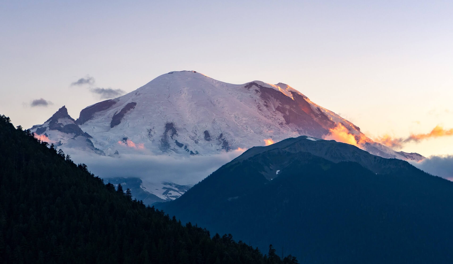 Snow-capped Mount Rainier volcanic mountain in Washington, USA