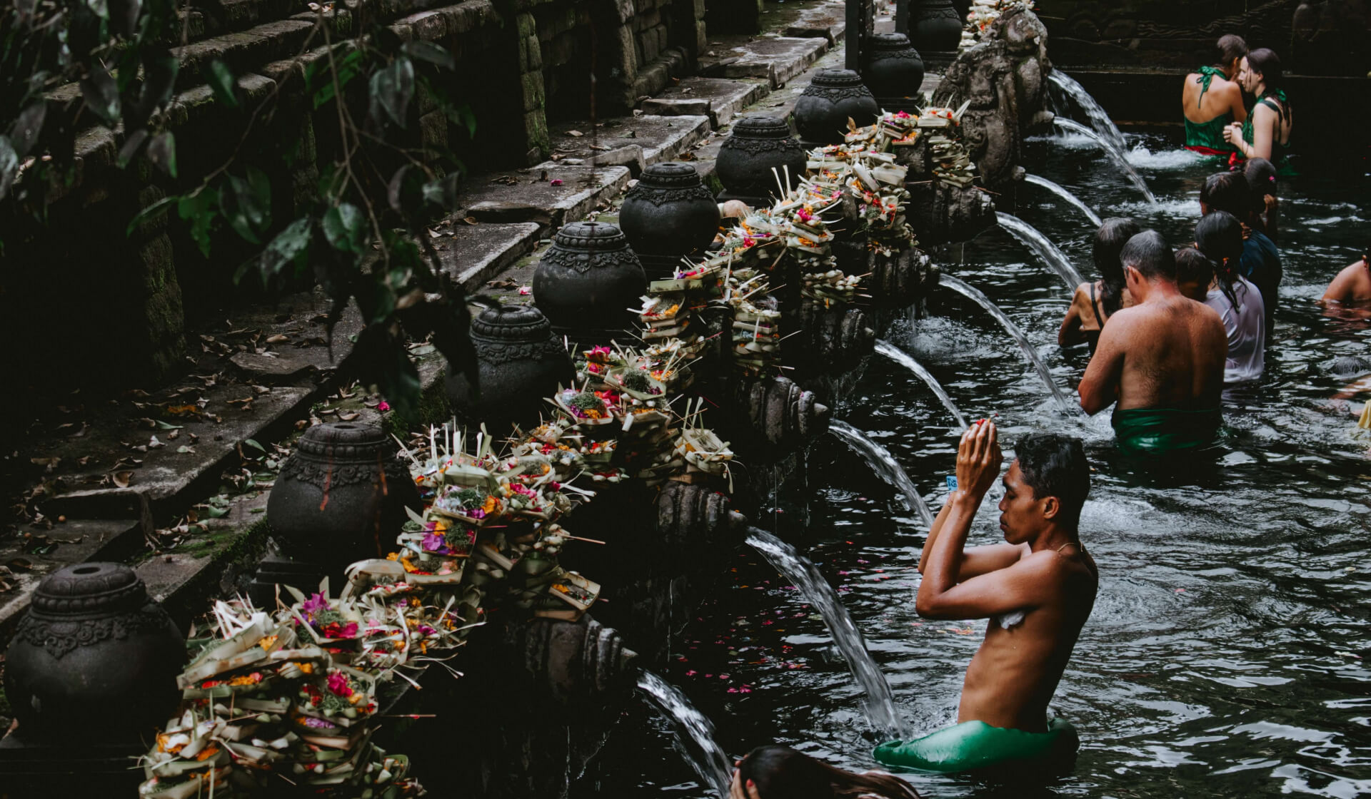 People bathing in the sacred water of the Balinese Tirta Empul Temple