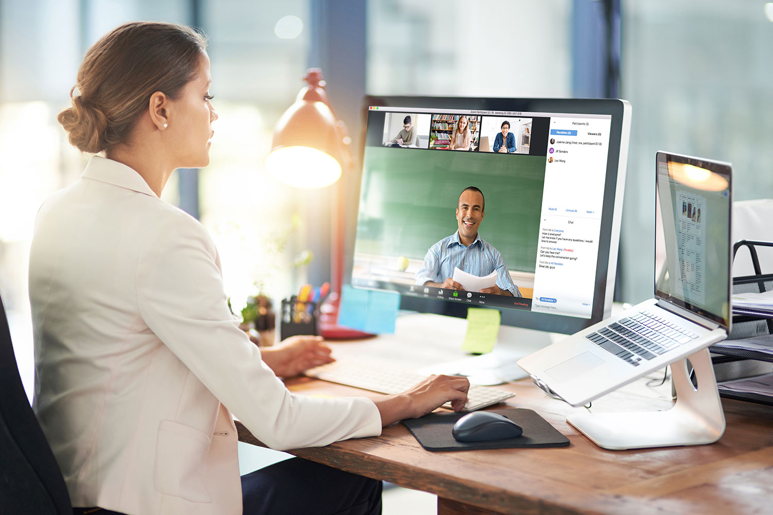 business woman meeting remote workers over video conferencing