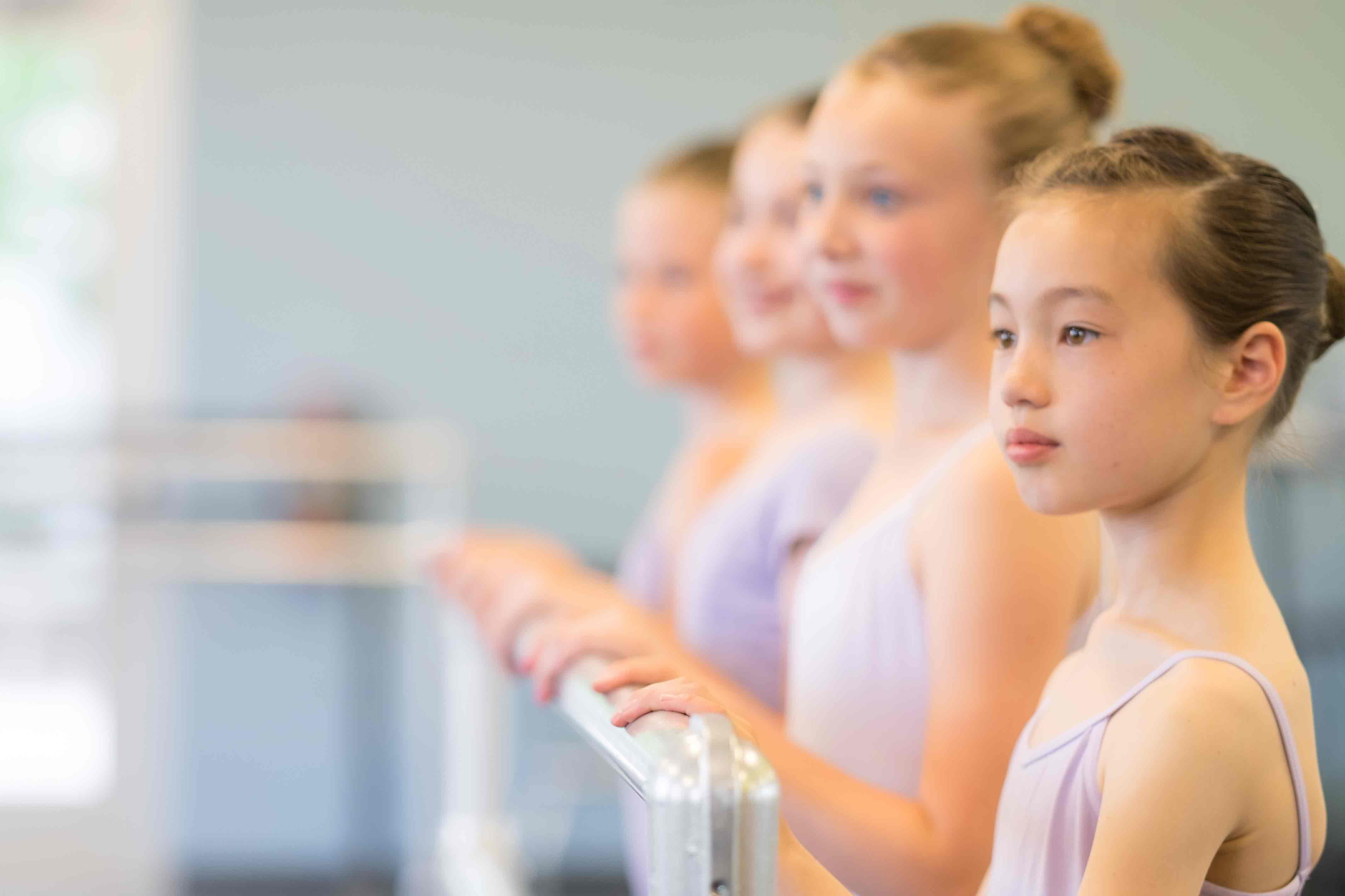Ballet students receive instruction while training at Eagle Performing Arts Center.