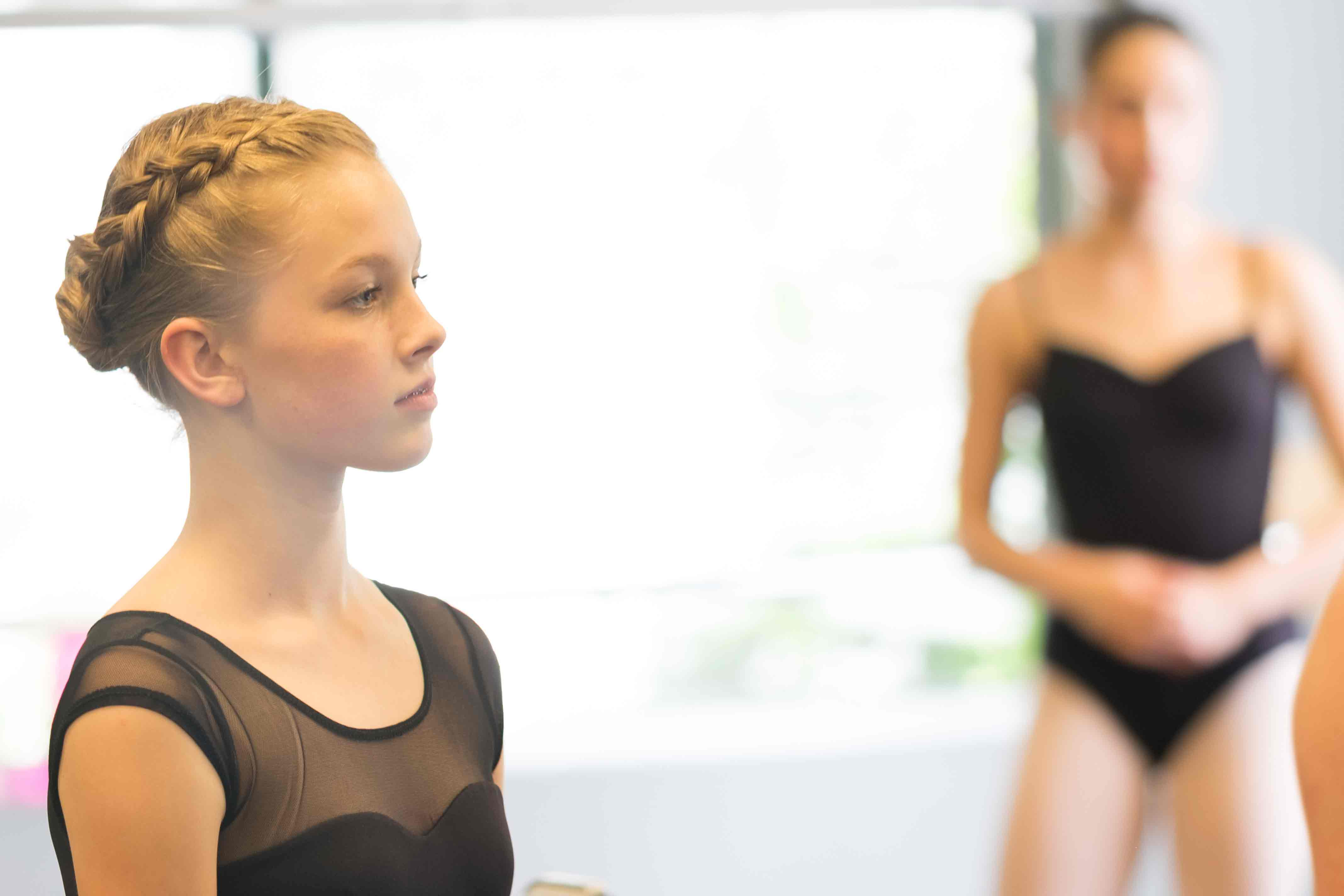 Ballet students listening during training at Eagle Performing Arts Center.