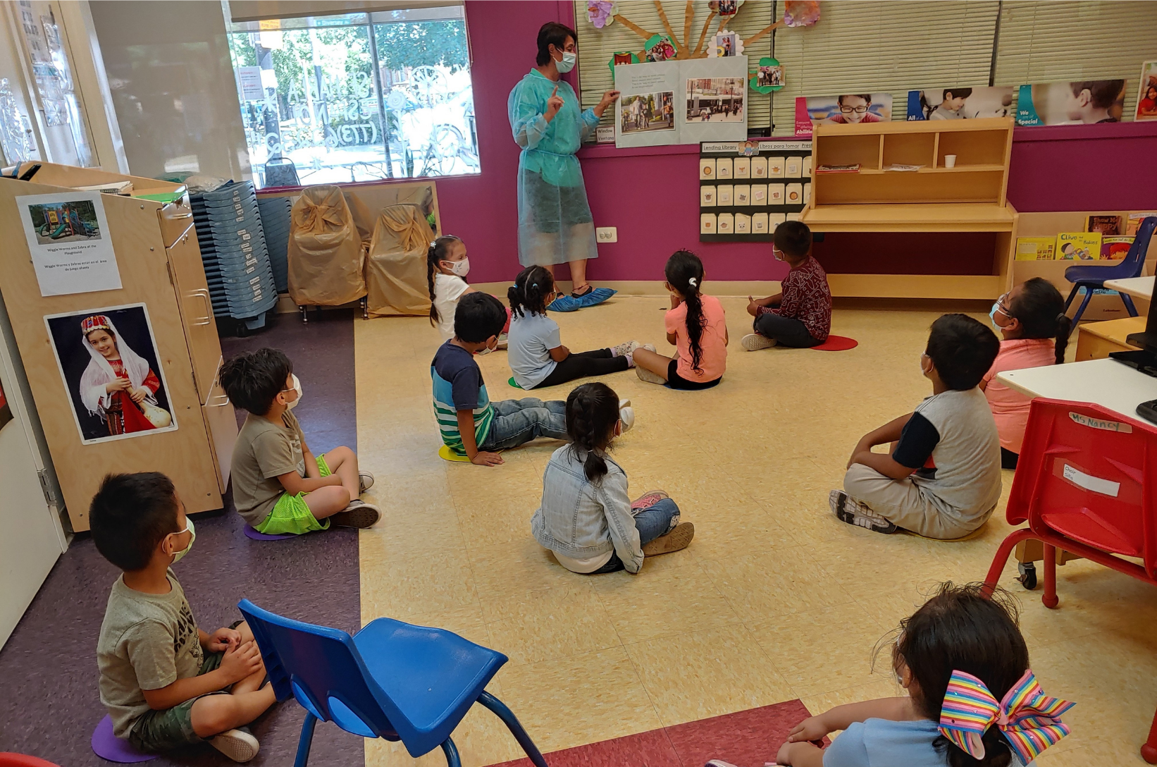 Young children in a socially-distanced classroom