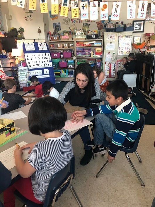 A Parent Mentor helps in a classroom at Goethe Elementary School in Logan Square