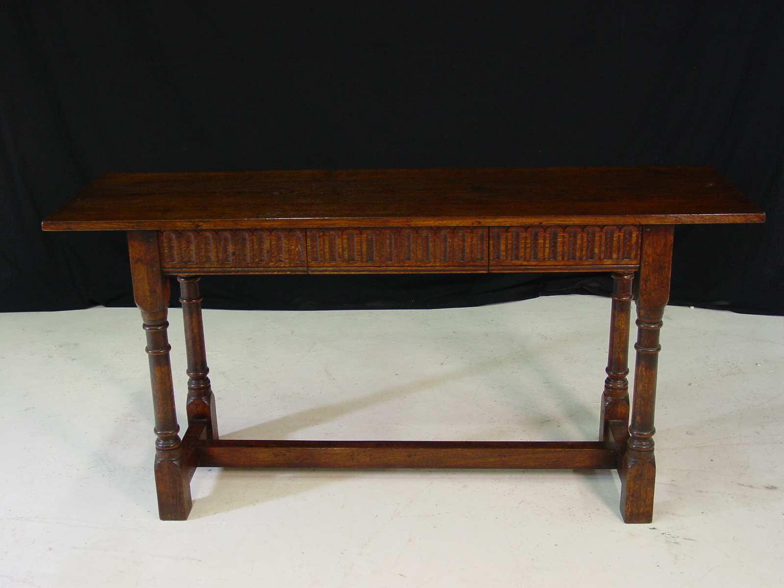 Oak carved apron side table with turned legs