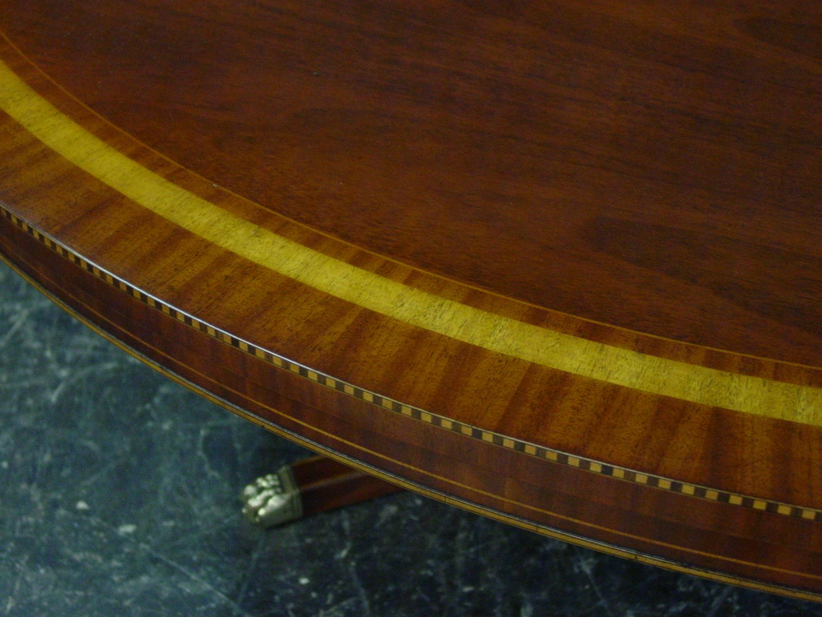 Table detail showing the custom satin banded mahogany table