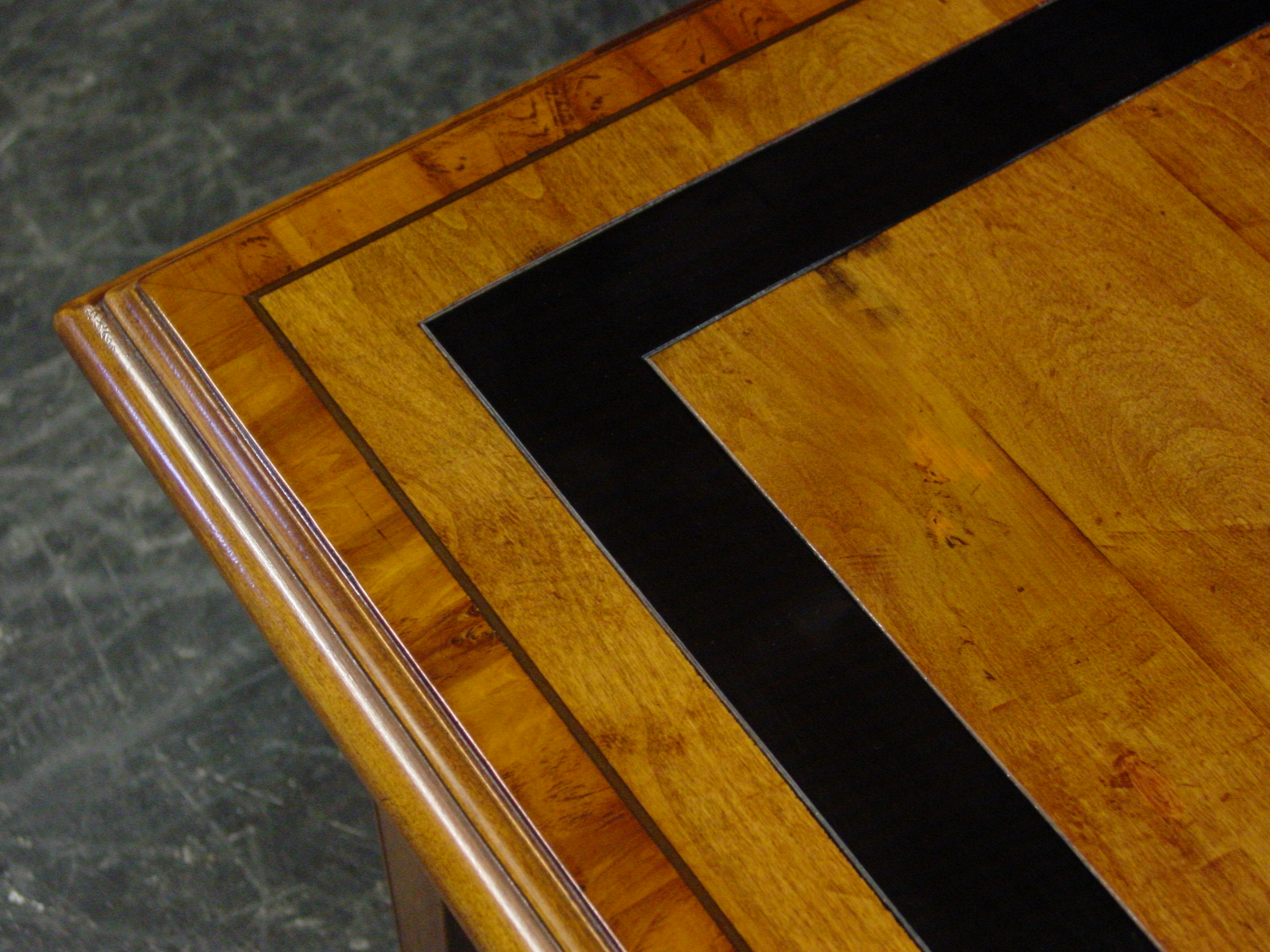 Close top details of the black etched inlay on farmhouse table