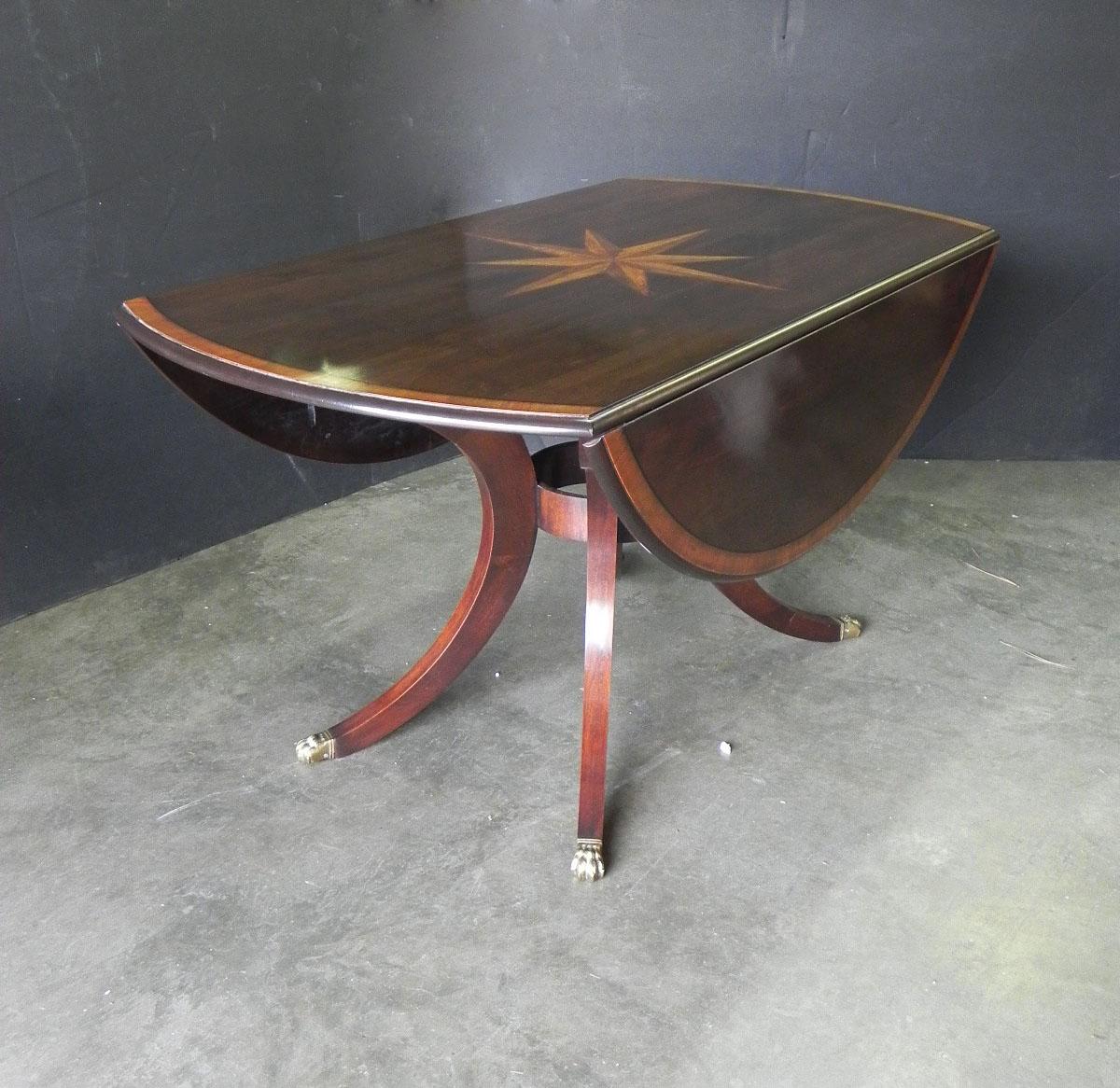 Custom drop leaf table with starburst inlay