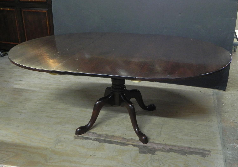 Custom cherry round extending pedestal table