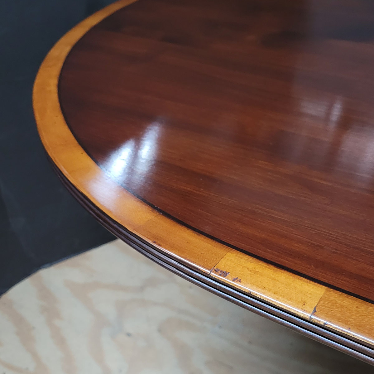 Racetrack top pedestal dining table