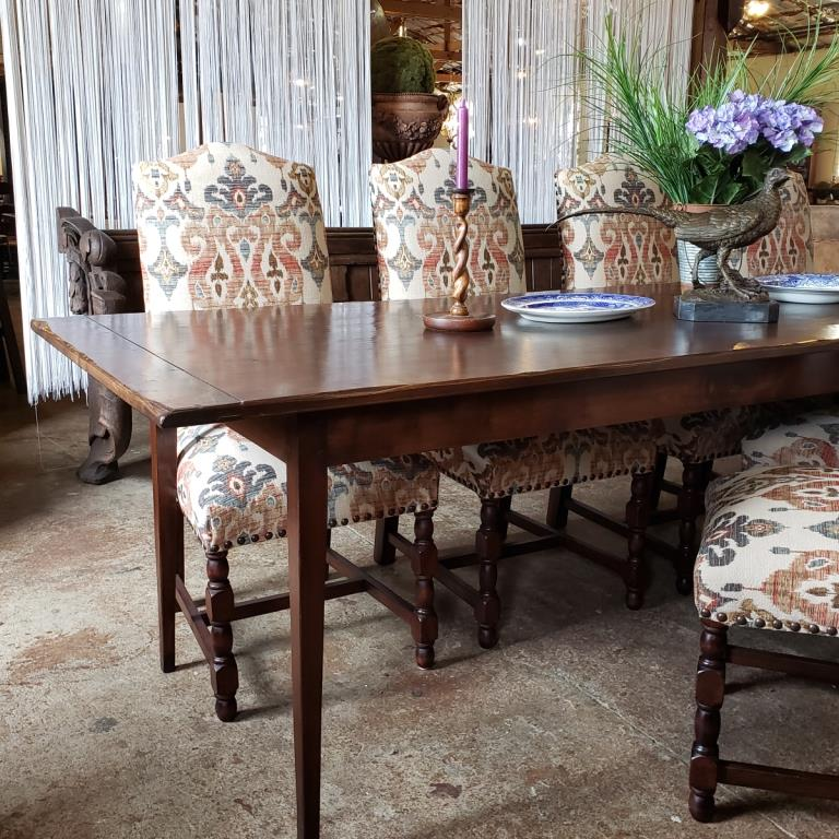 Tapered leg farmhouse style table with upholstered chairs