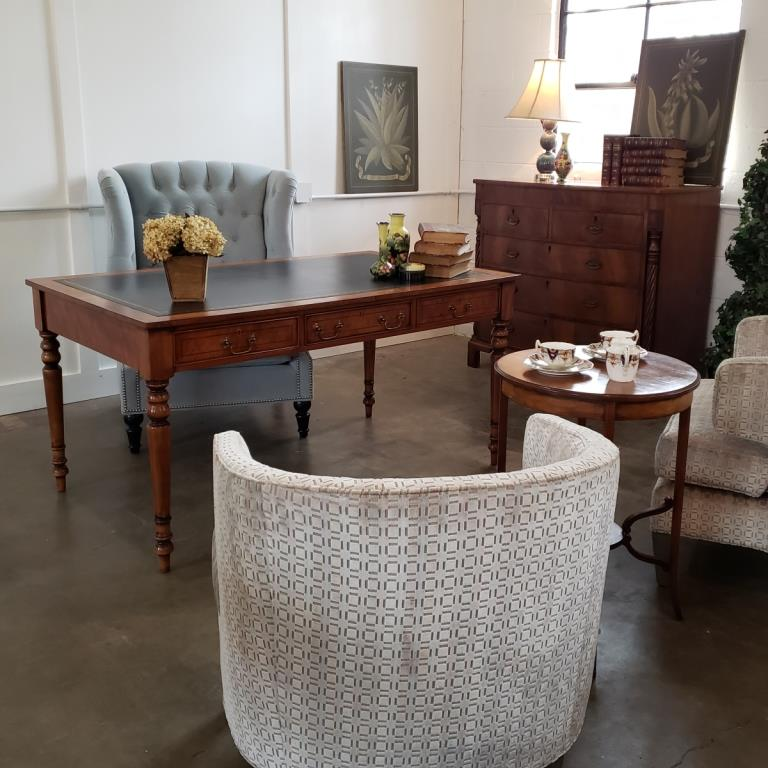 Beautiful furnishings for your office including a leather top writing desk
