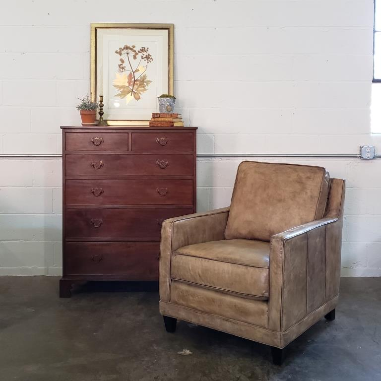 Josie leather chair with an antique chest