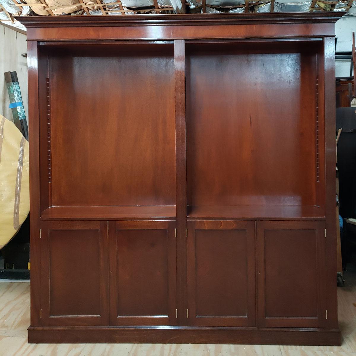 Custom open top mahogany bookcase with 2 doors below