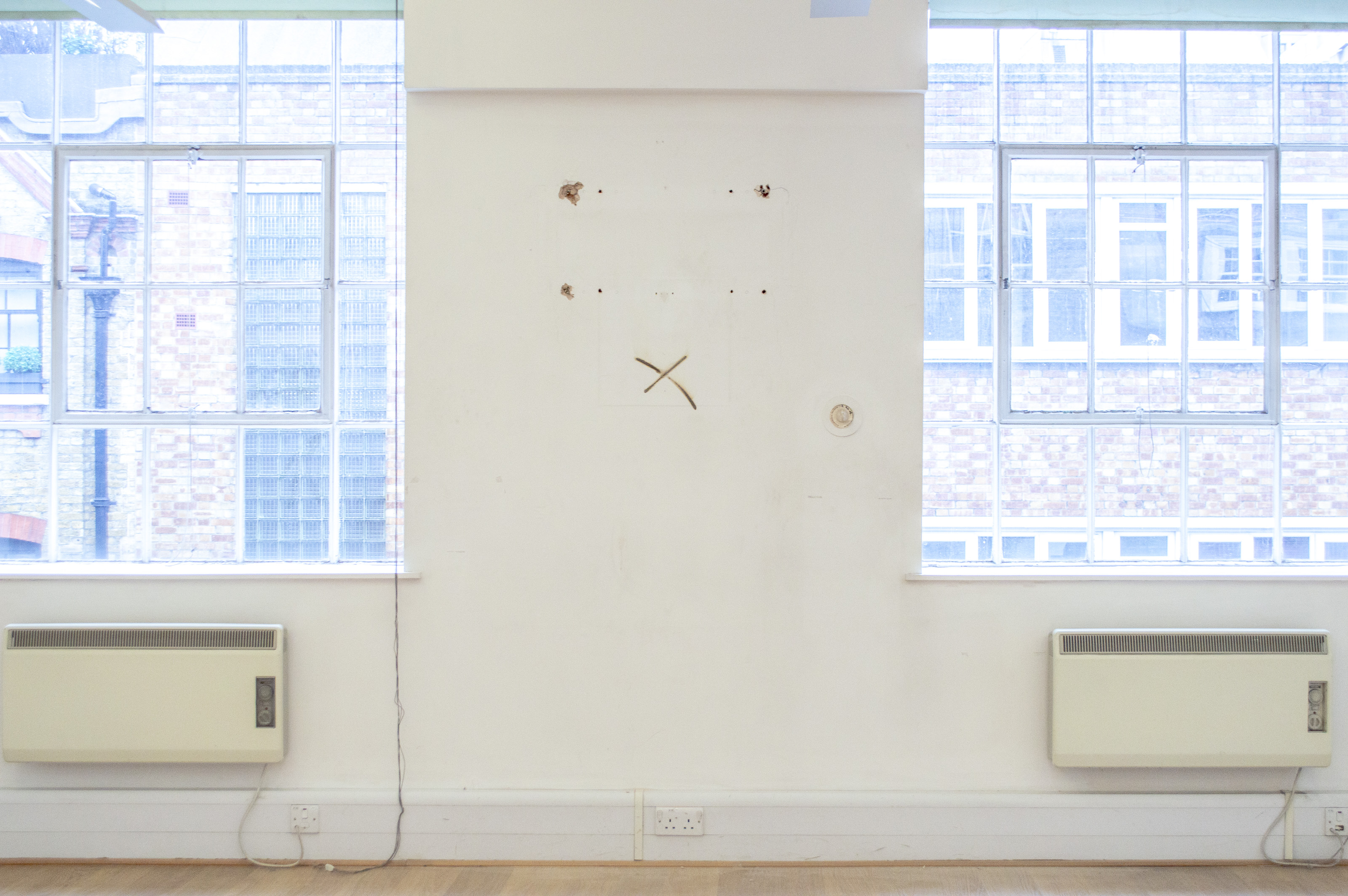 """Johanna Flato, """"X Asset: Imprint"""" wall imprint installation view, """"Viewing Room"""" curated by Bob Bicknell-Knight, Harlesden High Street, London, 2019 (photo courtesy of Bob Bicknell-Knight)"""