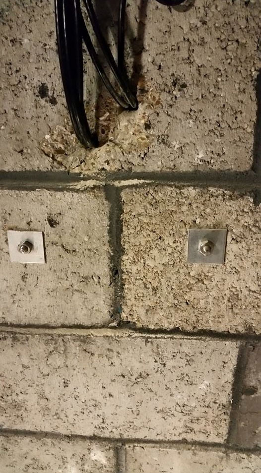 A picture of cables coming through wall