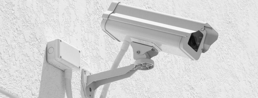 A photo of a CCTV camera on a wall