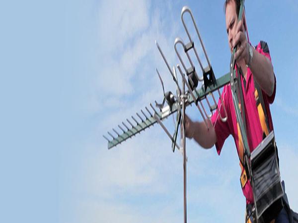 TV Aerial Installer Aligning TV Antenna