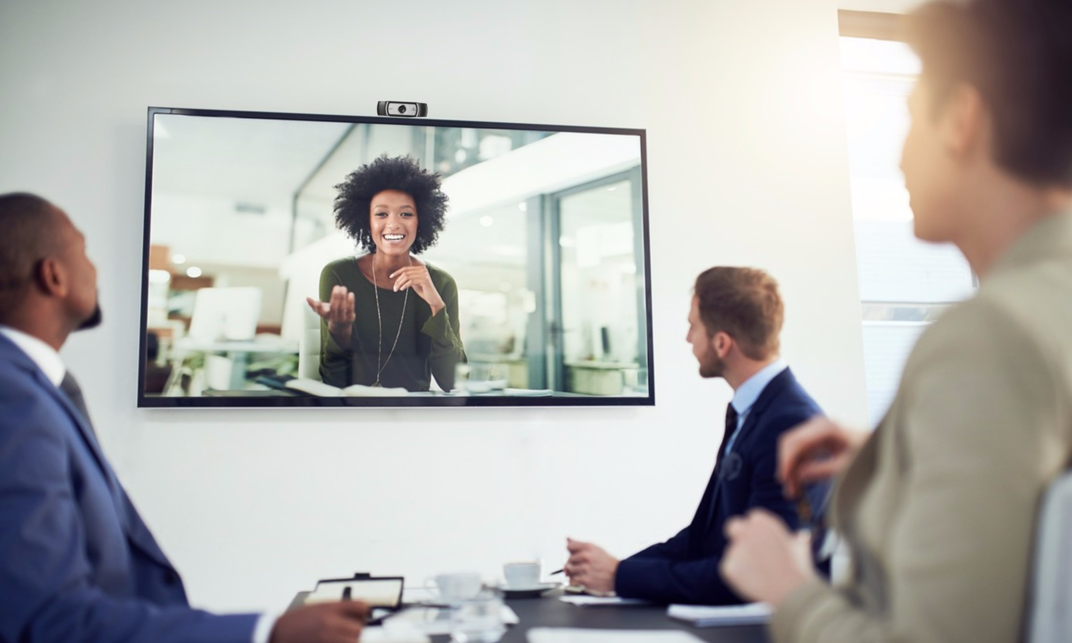 colleagues meeting in front of video conferencing screen