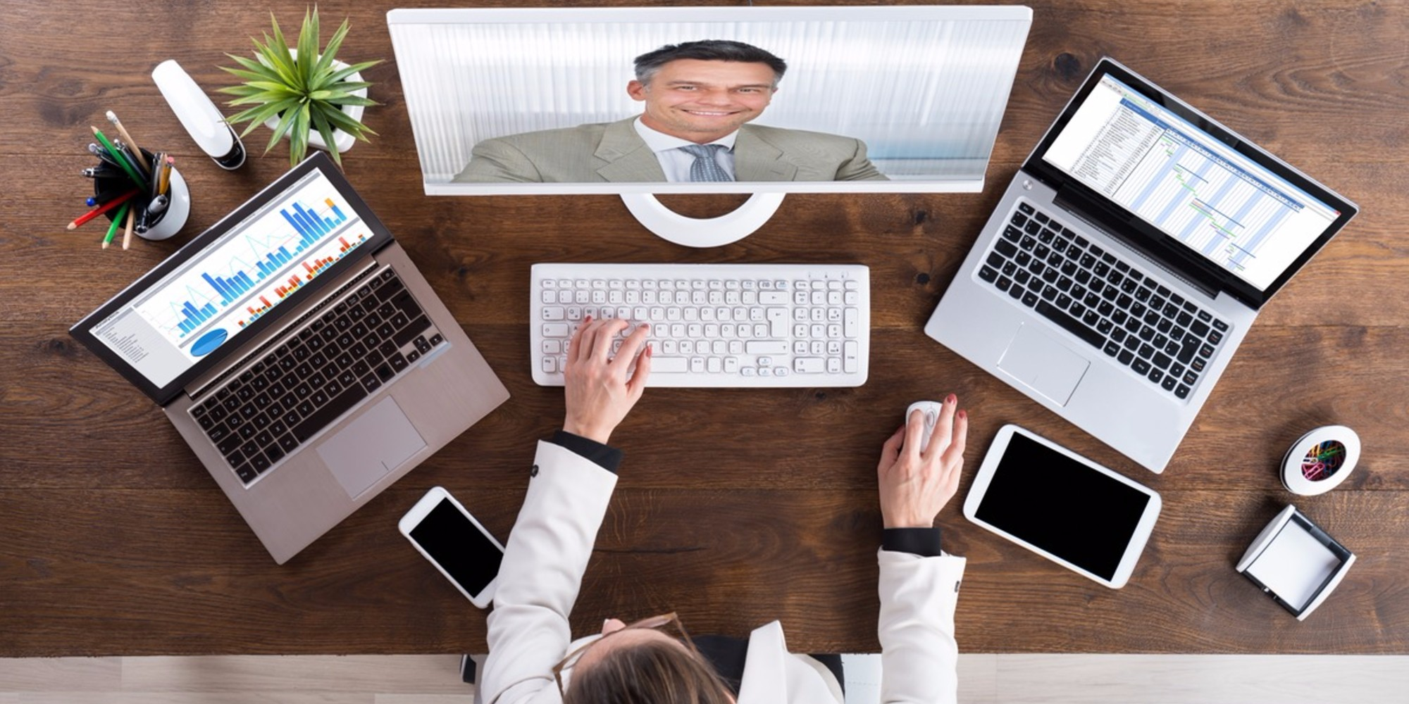 business woman having desktop video conference meeting with business man