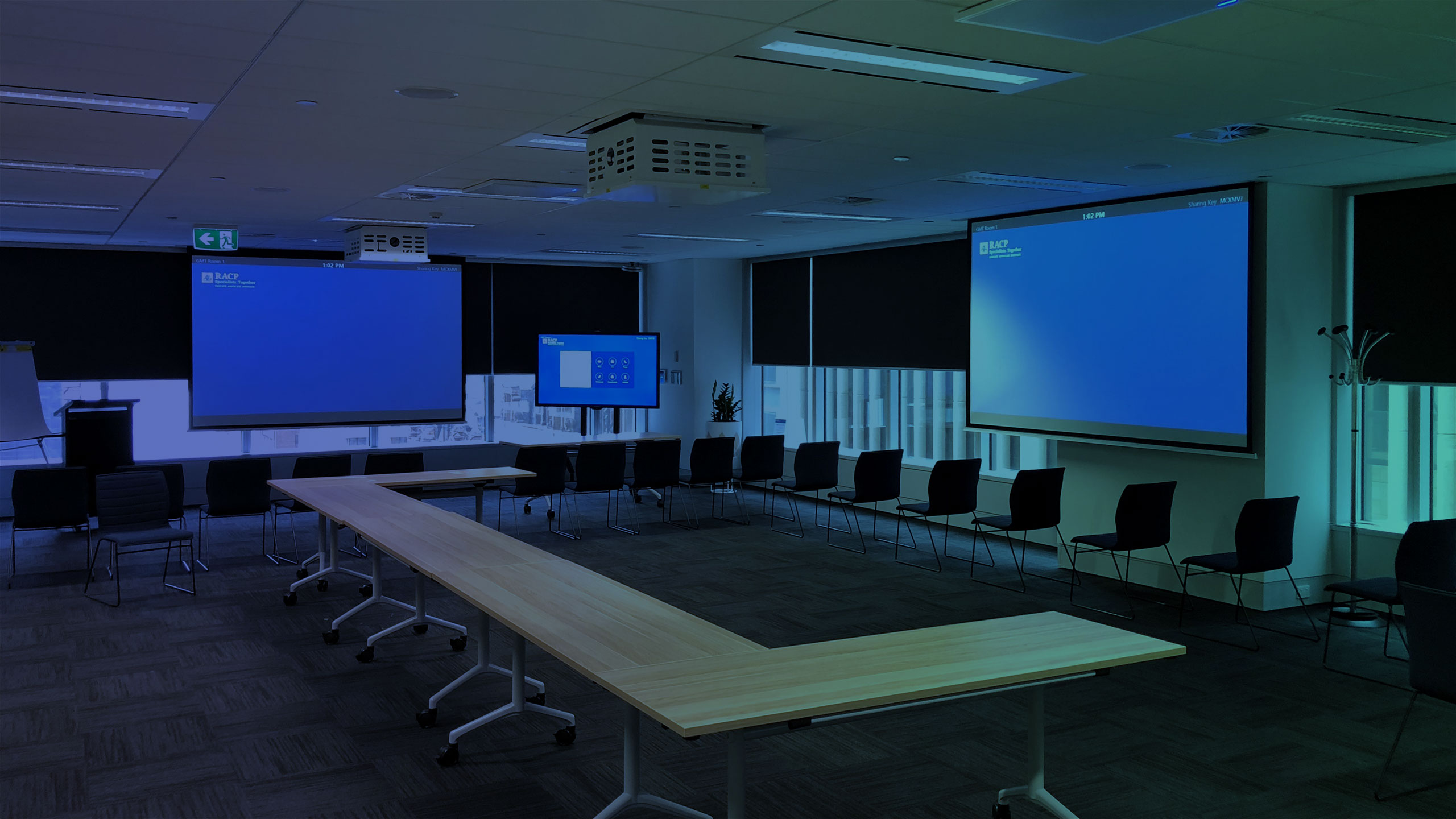 large conference room with projector screens