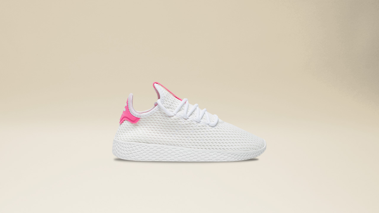 07dc3f13b9457 The accented tongue and heel is reminiscent of the adidas tennis classic  while exuding the lighthearted Pharrell Williams pallete.
