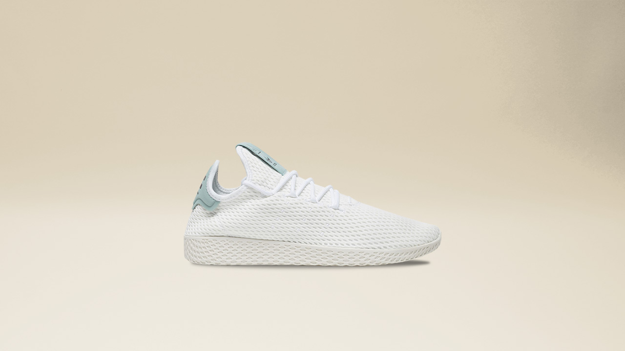 5797ad7df The accented tongue and heel is reminiscent of the adidas tennis classic  while exuding the lighthearted Pharrell Williams pallete.