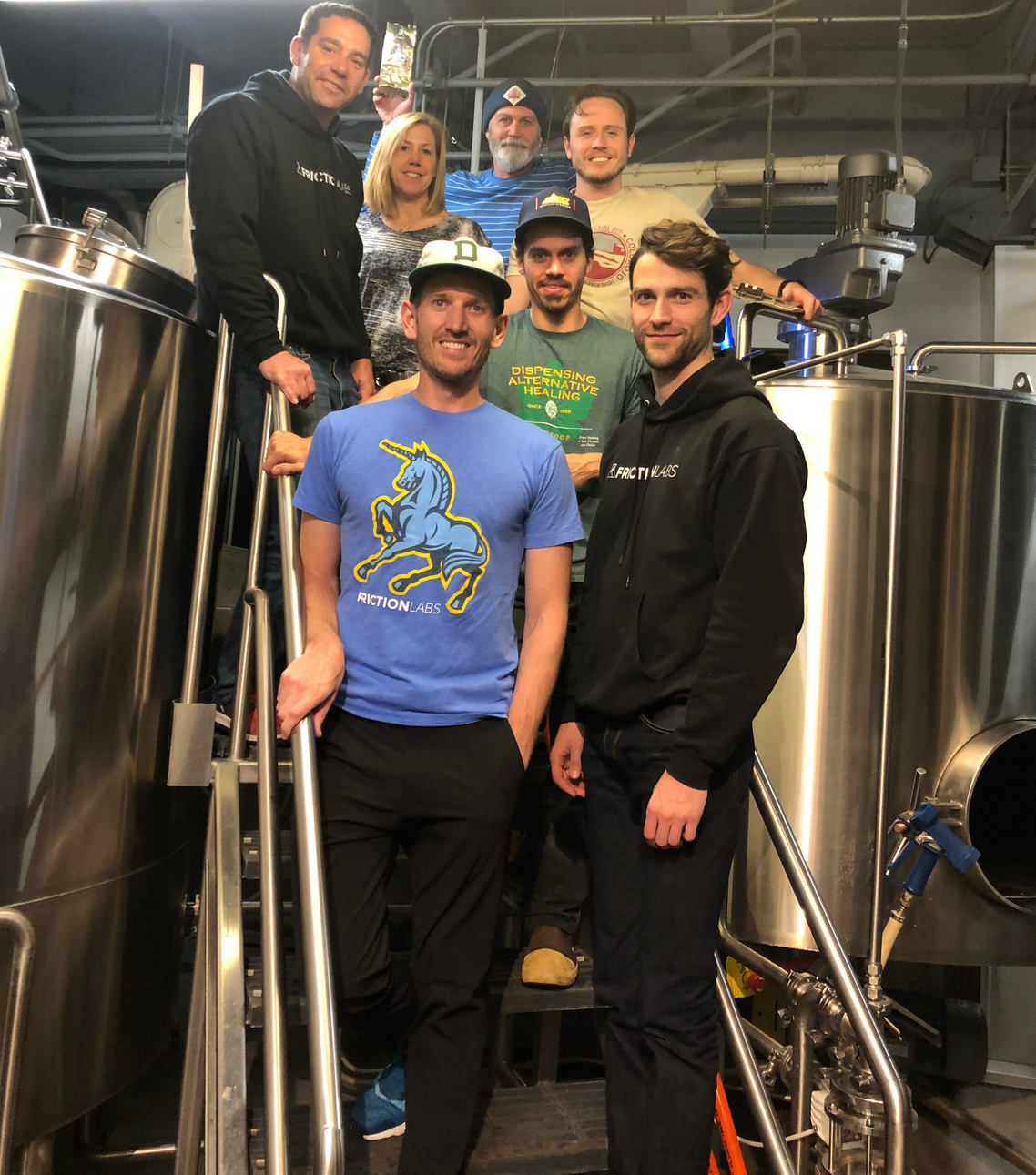 The Wynkoop Brewing and FrictionLabs teams in the brewery basement