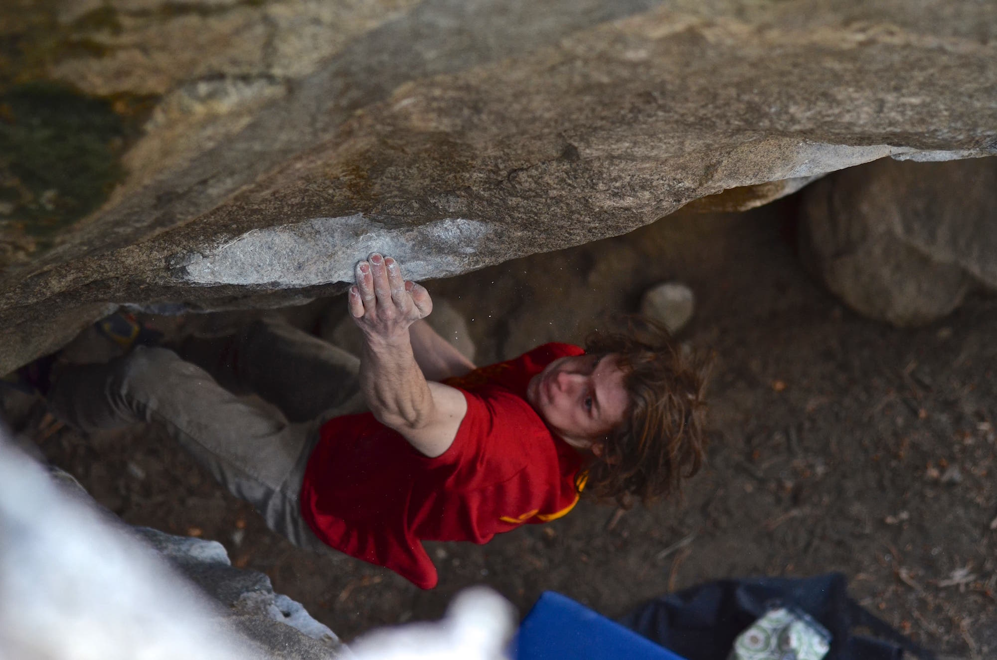 FrictionLabs Athlete Sam Rothstein climbing up a challenging boulder