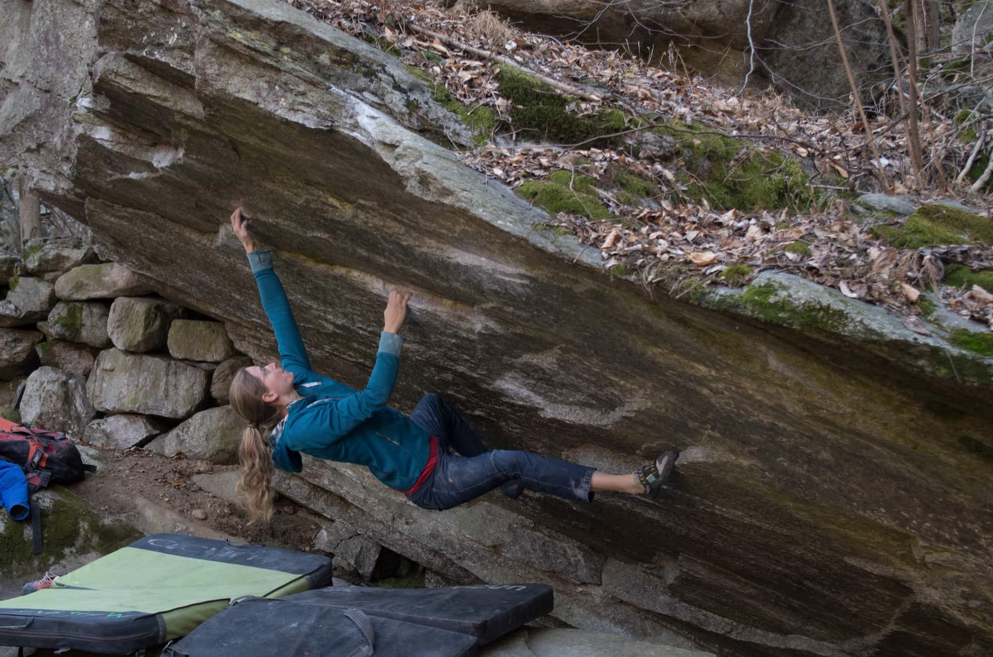 FrictionLabs Athlete Vera Warmbrunn climbing boulder in German