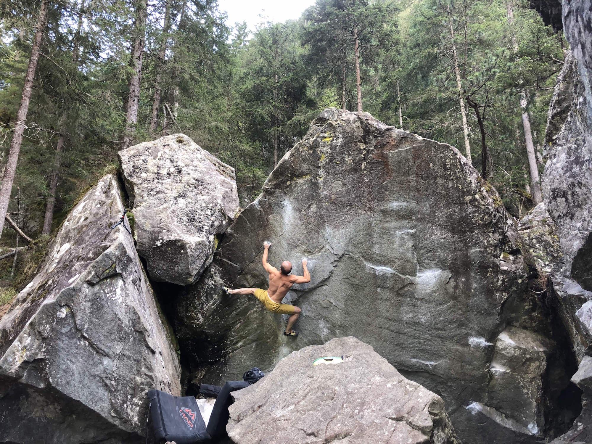 FrictionLabs Athlete Carlos Higuera climbing a tall boulder
