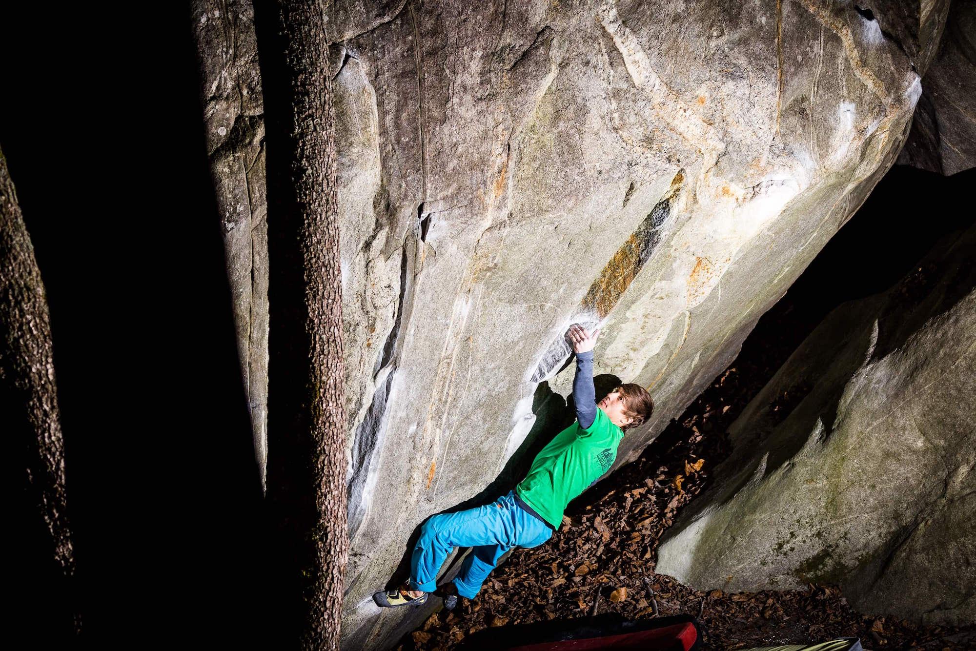 FrictionLabs Athlete Christof Rauch climbs a boulder