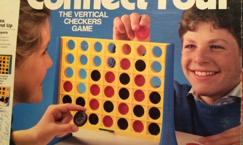 Kids playing 80s Connect Four