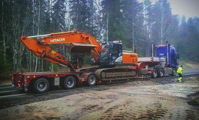 Lastebil med svane og graver