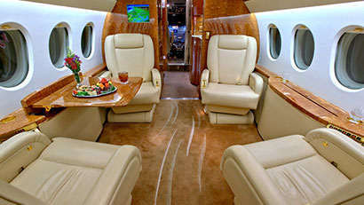 Book a Falcon 900B private jet.