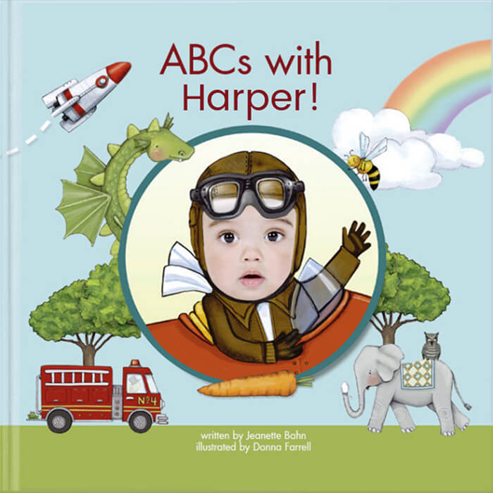 Personalized alphabet book cover featuring baby named Harper and her face inserted into a pilot illustration