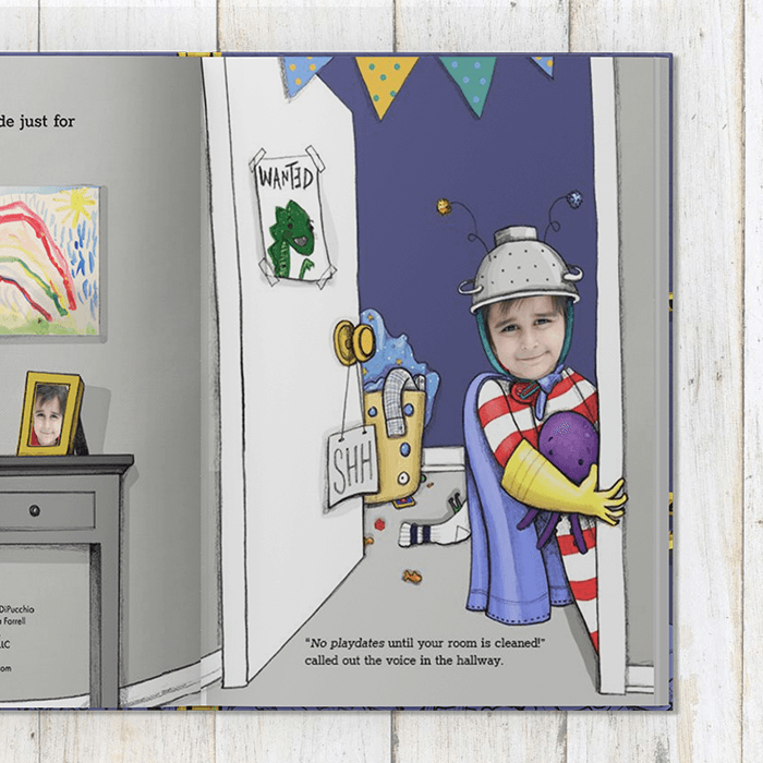 Page 1 of personalized book showing a child peering out of a bedroom doorway.  Child is dressed in red and white striped pajamas, with a makeshift helmet, yellow gloves and cape, while holding a purple octopus toy. Child's bedroom has blue walls with clothing strewn about on the floor