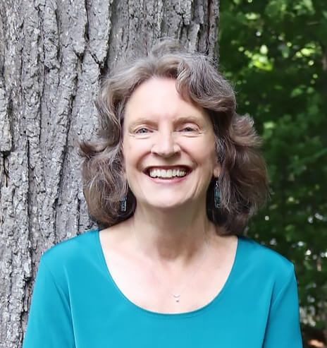 Photograph of children's book author Marsha Hayles, standing outdoors with a tree behind her