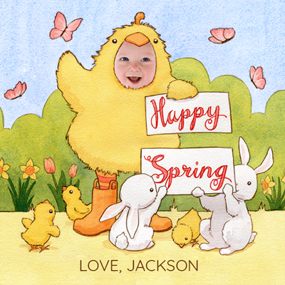 "A personalized Spring e-card, featuring a child named Jackson dressed as a yellow chicken holding a sign that reads ""Happy Spring"".  Small bunnies and chicks are at his feet with pink butterflies in the background. The card is illustrated except for Jackson's face which is a cropped photo of his face"